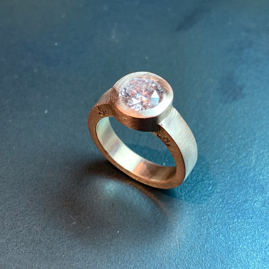 The custom engagement ring designed by Jeffrey Levin has been carved in wax, cast in rose gold and features and stunning diamond.