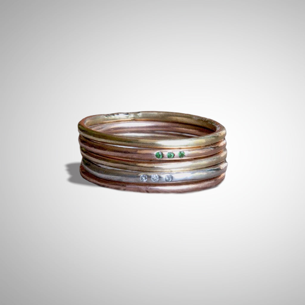 Jeffrey Levin's super skinny rings pair well with engagement rings and wedding bands.