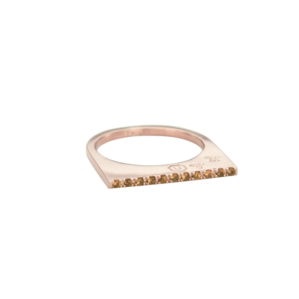 Add dramatic height and sparkle to your stacking rings with Jeffrey Levin's super flat skinnys encrusted in diamonds or colorful gems. Inspired by beautiful bon bon desert plating, Jeffrey Levin designed a unique proportion and stunning surface in 14k rose gold with pave set cognac diamonds.