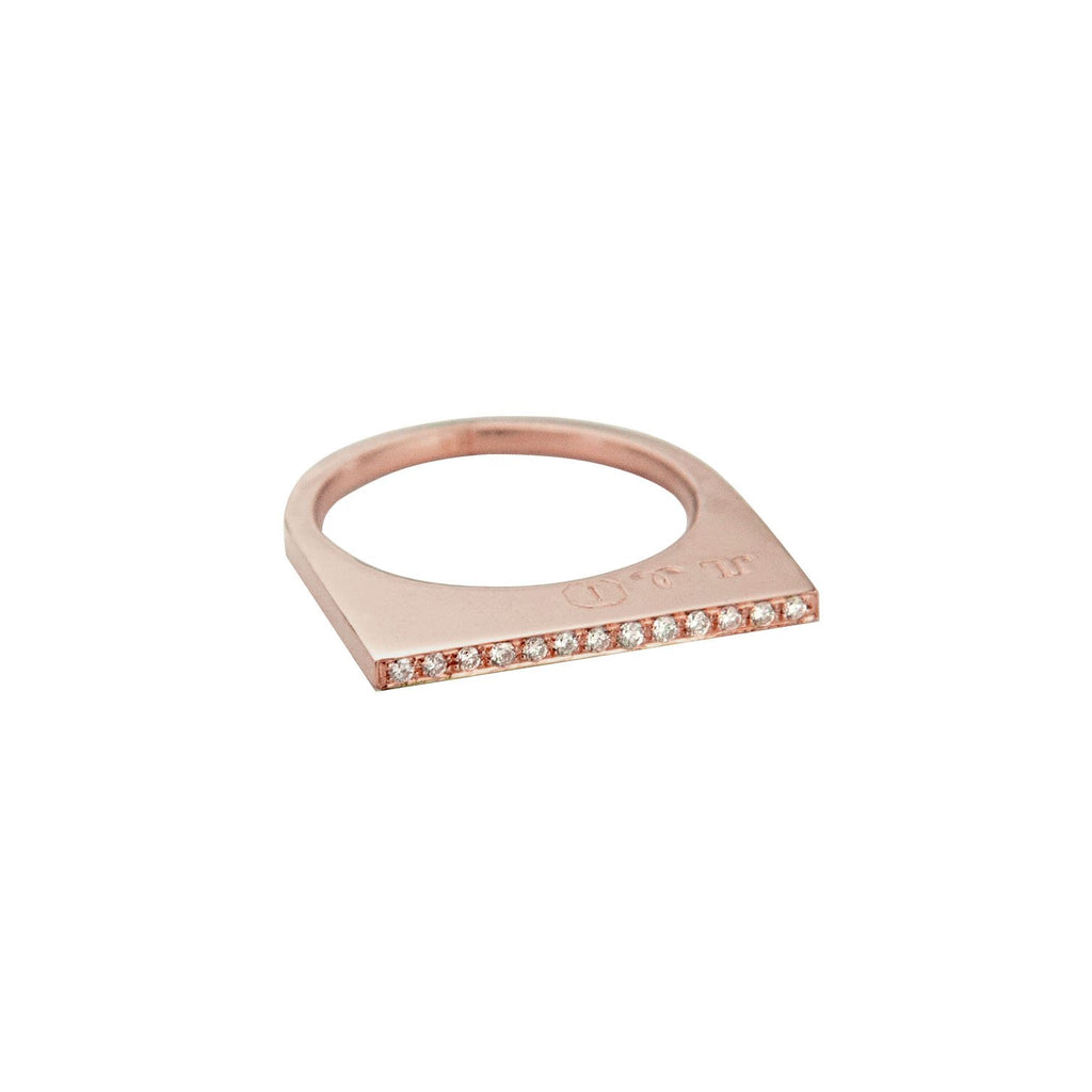 Add dramatic height and sparkle to your stacking rings with Jeffrey Levin's super flat skinnys encrusted in diamonds or colorful gems. Inspired by beautiful bon bon desert plating, Jeffrey Levin designed a unique proportion and stunning surface in 14k rose gold with pave set diamonds.