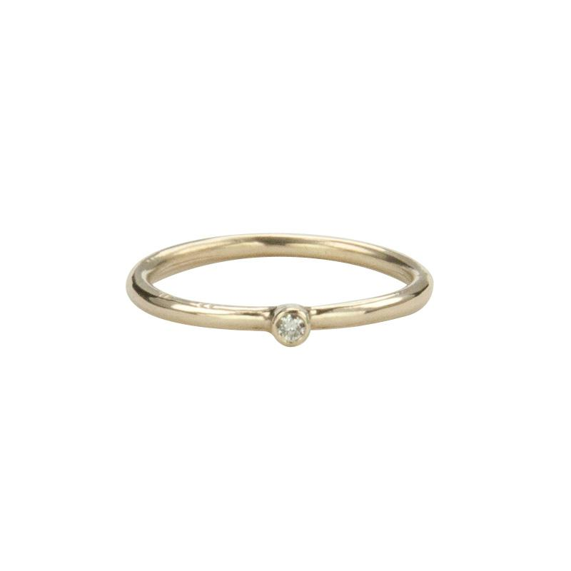 Jeffrey Levin Super Skinny stacking ring in 14K yellow gold with single stone white diamond is delicate and designed for stacking.