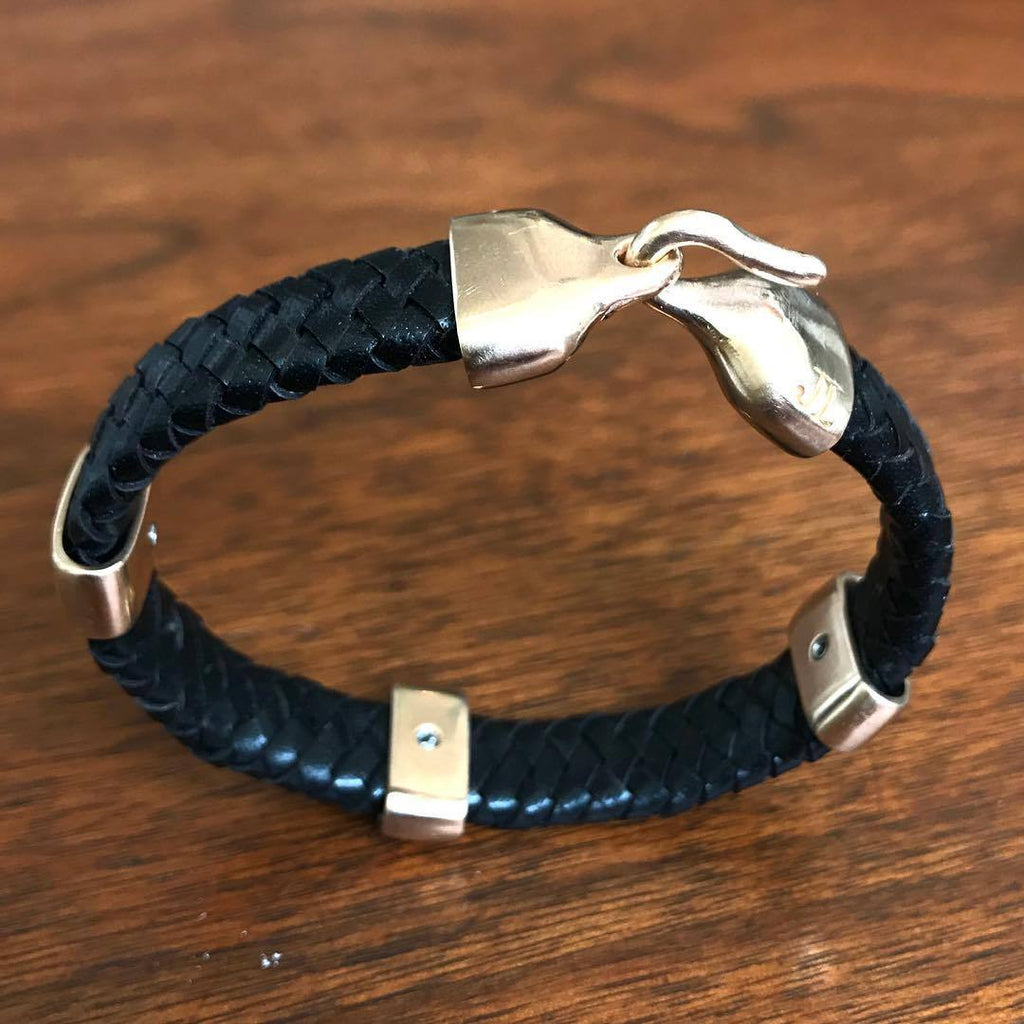 Jeffrey Levin sterling silver and braided black leather bracelet with 3 silver bands and handcrafted sleek hook clasp.