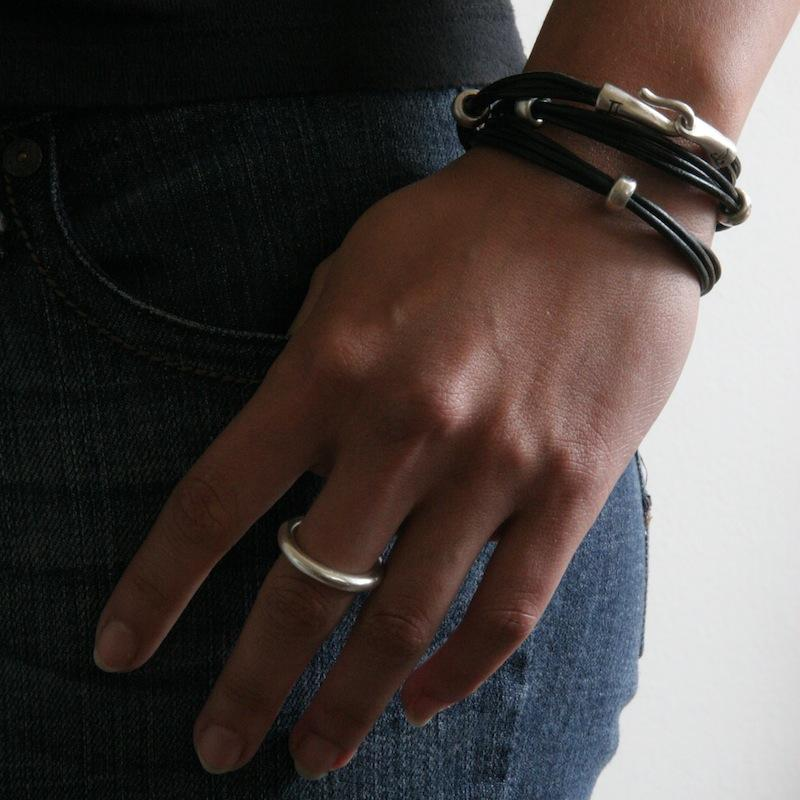 Stunning layered or alone–goes with everything, thick round stacking rings by jewelry designer Jeffrey Levin. Mixed metals available in sterling silver; 14k yellow, white or rose gold; or platinum. Shown on model with Jeffrey Levin triple wrap leather bracelet.