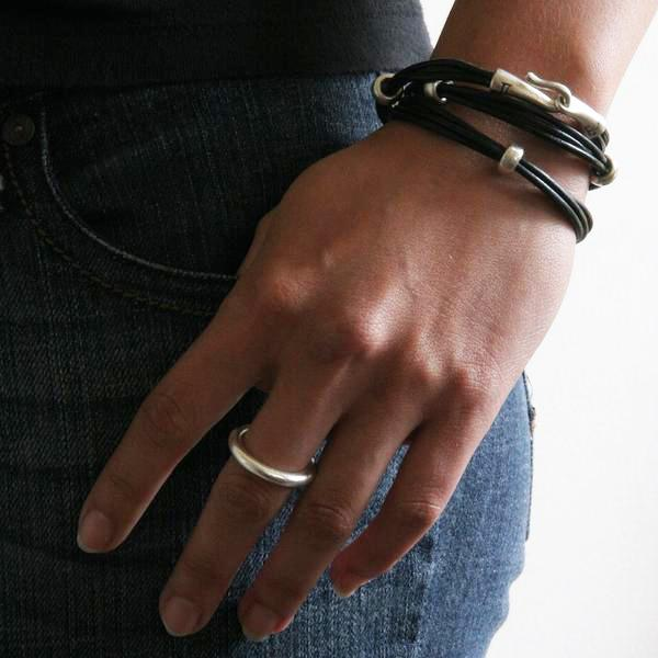 "Jeffrey's double wrap leather bracelet is a modern and versatile streetwear accessory. The specially designed handcrafted sterling silver hook and eye clasp is reimagined from the old Roman style. The black leather wrap is embellished with 3 handcrafted sterling silver ""donut"" beads."