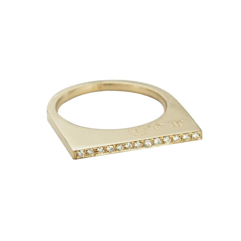 Add dramatic height and sparkle to your stacking rings with Jeffrey Levin's super flat skinnys in 14K yellow gold encrusted in diamonds or colorful gems. Inspired by beautiful bon bon desert plating, Jeffrey designed a unique proportion and stunning surface in mixed metals with pave set diamonds.