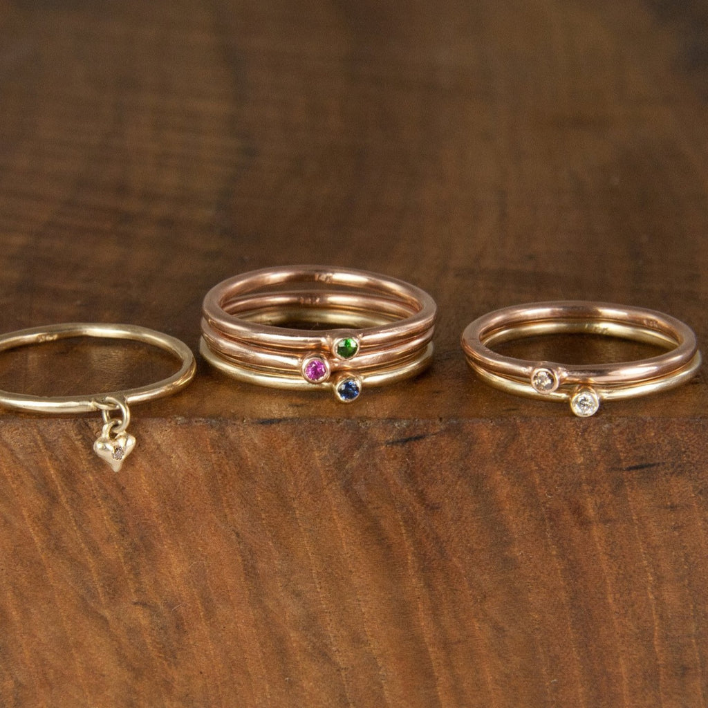 These super skinny stacking rings by Jeffrey Levin are adorned with single stones in your mix of precious metals and gems. They're are delicate, simple and personal. Wear alone or stack with your blend of plain, 3-stone burnished or other single-stone bezel set skinny rings in mixed metals and with diamonds or colorful gems.