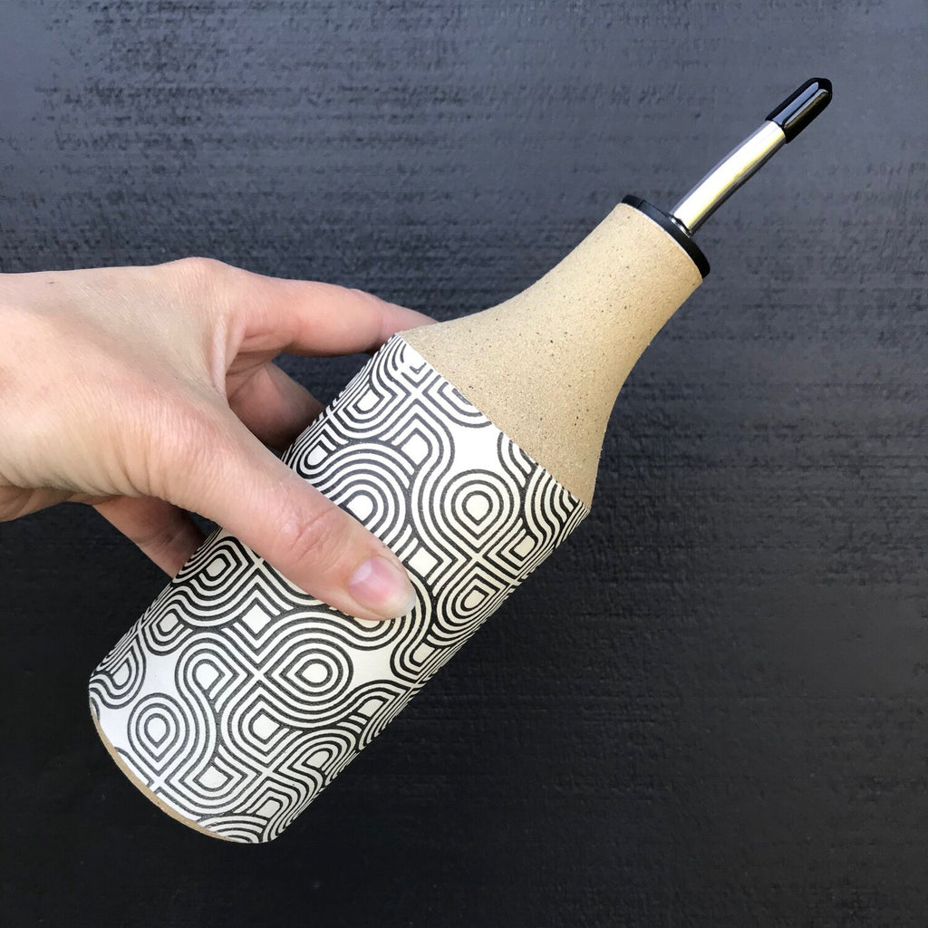 Your olive oil and vinegar pour just got an upgrade with these super cool oil bottles. Julems created the geometric design then screen printed it on a layer of white slip.