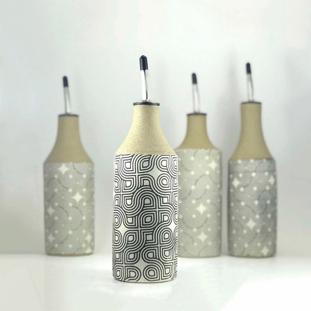 Your olive oil and vinegar pour just got an upgrade with these super cool oil bottles. Judith created the geometric design then screen printed it on a layer of white slip.