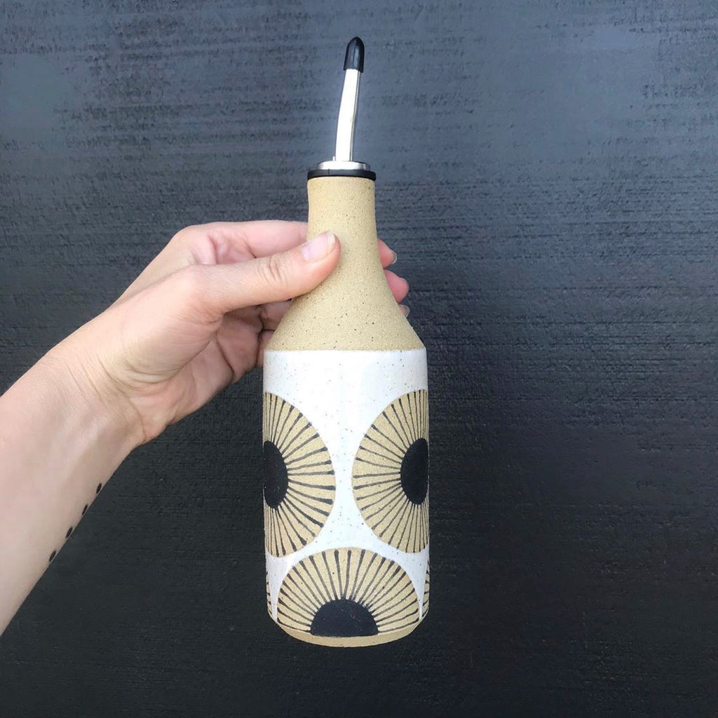Your olive oil and vinegar pour just got an upgrade with these super cool oil bottles. Judith Lemmens, designer behind the Julems line of wheel thrown ceramics, hand drawers her Scandinavian inspired sunburst design over naked clay.