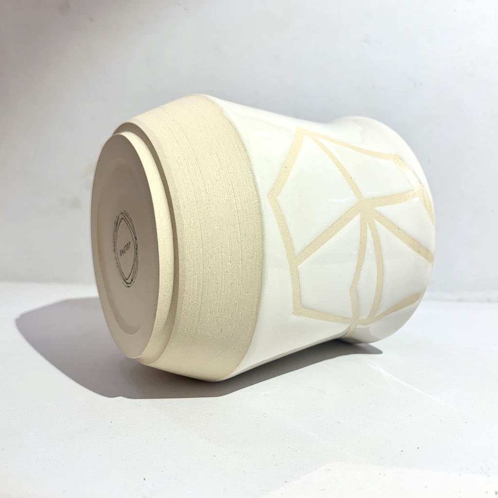 Julems Ceramics x Poet and/the Bench mug with element design, alternate placement, laying down for side and bottom view