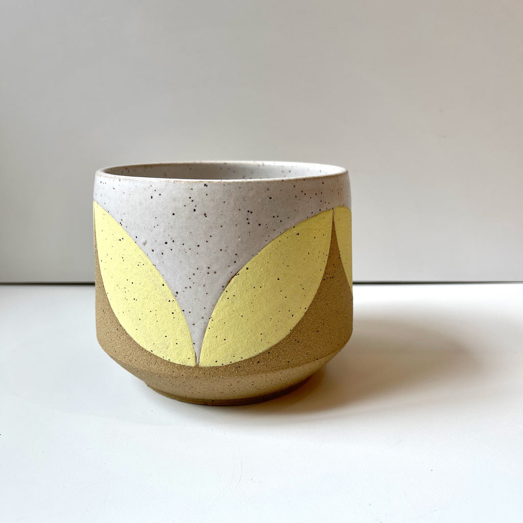 Julems Ceramics planter with yellow leaf design.