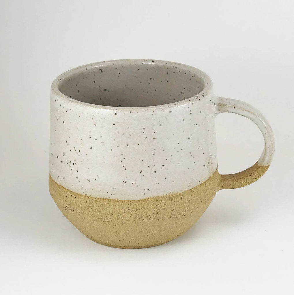 Get cozy with a warm cup. This substantial beauty comes in 14oz or 10oz to hold your favorite beverage or soup. We love the neutral palette. Judith Lemmens, designer behind the Julems line of wheel thrown ceramics is Dutch and derives inspiration from mid-century and Scandinavian design.