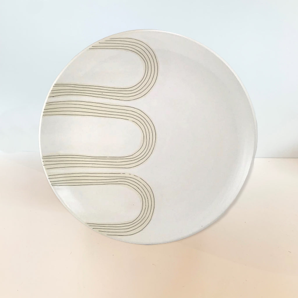 We love the blade-made arch design that Judith uses across pottery in her mid-century inspired designs. Makes for an elegant dinner or serving plate, wall or shelf decoration.