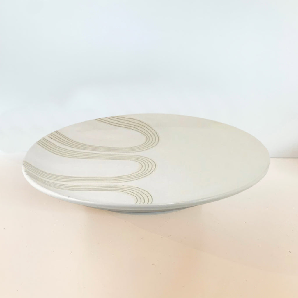 We love the blade-made arch design that Judith uses across pottery in her mid-century inspired designs. Makes for an elegant dinner or serving plate, wall or shelf decoration. Top view.
