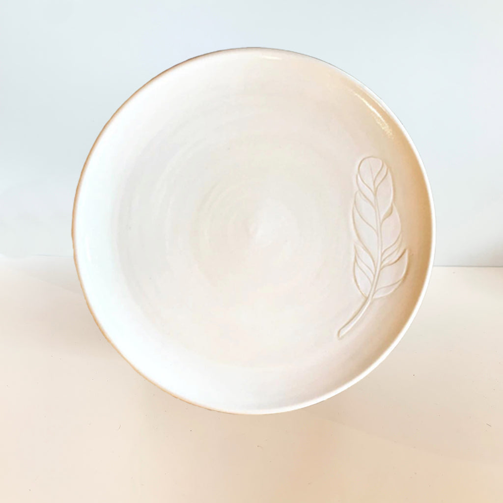 It's your new fave dinner plate, serving plate, warm-chocolate chip cookie plate. Judith uses the sgraffito technique to create her more organic elements such as this feather.