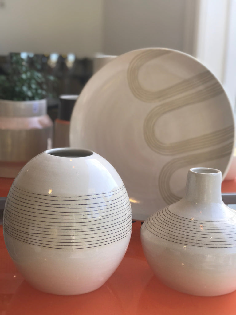 We love the blade-made arch design that Judith uses across pottery in her mid-century inspired designs. Makes for an elegant dinner or serving plate, wall or shelf decoration. Shown in group with two vases.