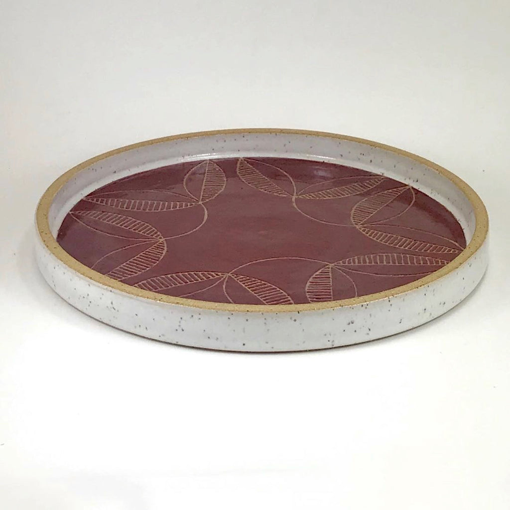 Judith's fine line work and the burgundy glaze in this wheel thrown platter make this a beautiful option for presentation or display.