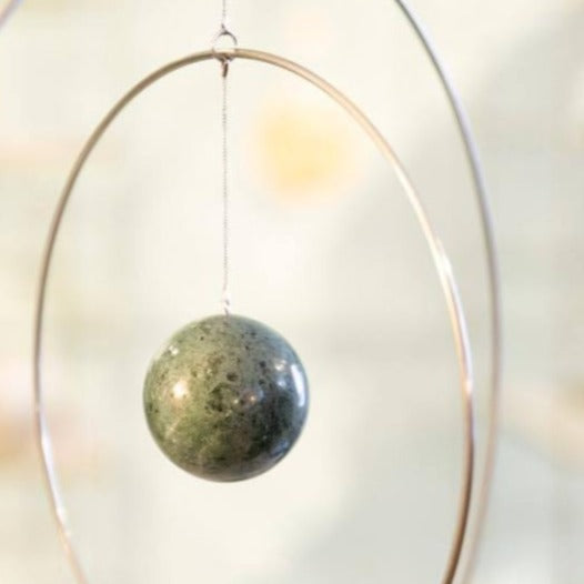 These sculptural Galaxy Globe wall hangings are artful Scandinavian design at its most elegant with a twist of Japanese and Italian inspiration. Marble detail.