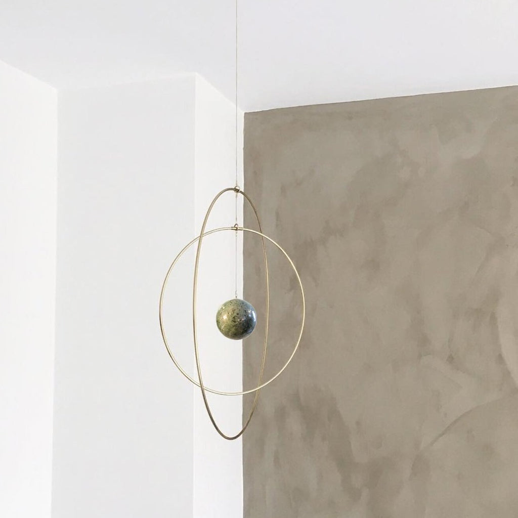 These sculptural Galaxy Globe wall hangings are artful Scandinavian design at its most elegant with a twist of Japanese and Italian inspiration. The brass rings are a signature of Copenhagen architect and home decor designer Kaja Skytte's product line, while custom designed marbles (mostly from Italy) are a recurring motif in her designs.