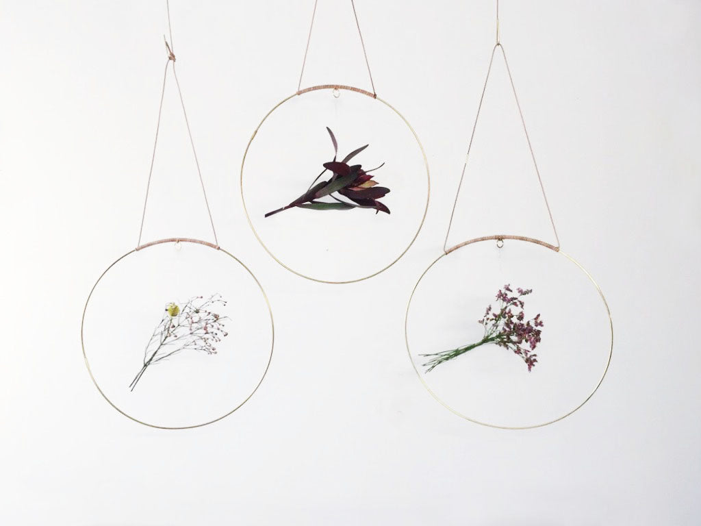 Halo is a beautiful circular mobile made for you to create pretty, earthy radiance. Add a flower cutting from your garden, a sprig of herbs, air plant, a paper flower, or whatever inspires you in the moment. Add flower cuttings from your garden or a bouquet.