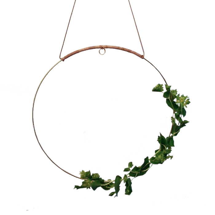 Halo is a beautiful circular mobile made for you to create pretty, earthy radiance. Add a flower cutting from your garden, a sprig of herbs, air plant, a paper flower, or whatever inspires you in the moment. Change it often. Hang it to hold space.