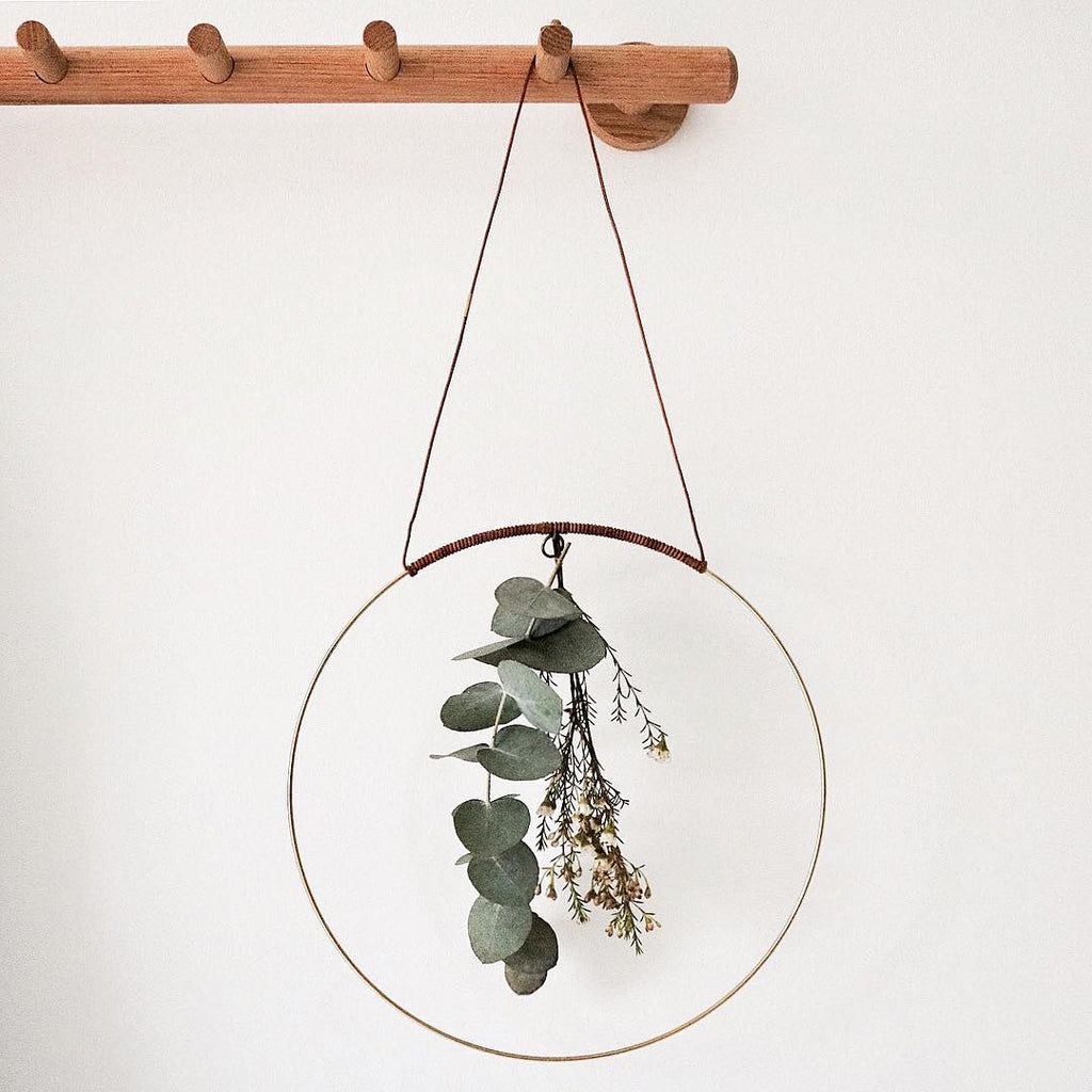 Halo is a beautiful circular mobile made for you to create pretty, earthy radiance. Add a flower cutting from your garden, a sprig of herbs, air plant, a paper flower, or whatever inspires you in the moment. Add dried leaves and floral cuttings. Change often.