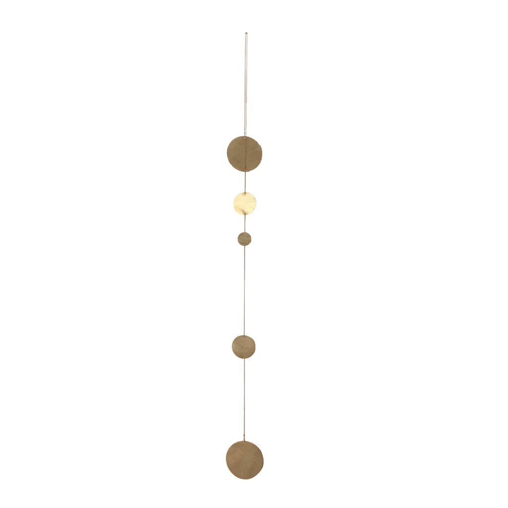 Rain is a beautiful hanging mobile made from Copenhagen architect Kaja Skytte out of brass discs and chain.