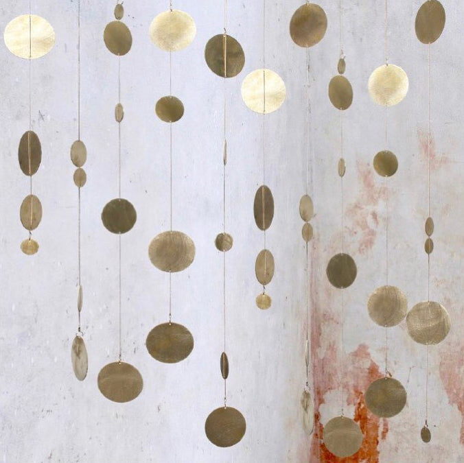 Rain is a beautiful hanging mobile made from brass. A single rain is beautiful wall hanging on it is own but a big cluster of rain makes a fantastic sculpture. Each Rain looks different as you can adjust the length and the placing of the circles.
