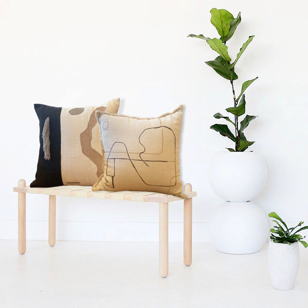 This gorgeous one of a kind pillow is sewn from sustainably sourced fabrics, added yarn trim, and hand painted. Designer Kalla McGuire's abstracts are evocative of the California environments that surround her. We love the sculptural / architectural feel of this design.