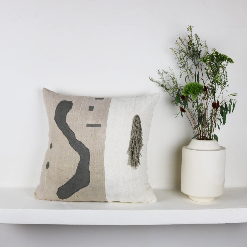 We love designer Kalla McGuire's use of hand loomed cotton remnants from sustainable fabric designers, sewn together to create a new pattern. She then manipulates fabrics in various ways. In this case, with her muted tones Koraju pillow, she hand painted the original abstract design.
