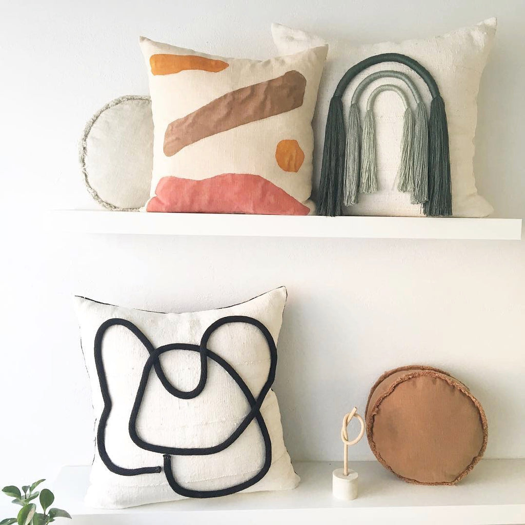 This gorgeous pillow (shown top left) is sewn from sustainably sourced fabrics and hand painted.  Designer Kalla McGuire's landscapes are evocative of the California environments that surround her. We have a pair of these one-of-kind pillows.