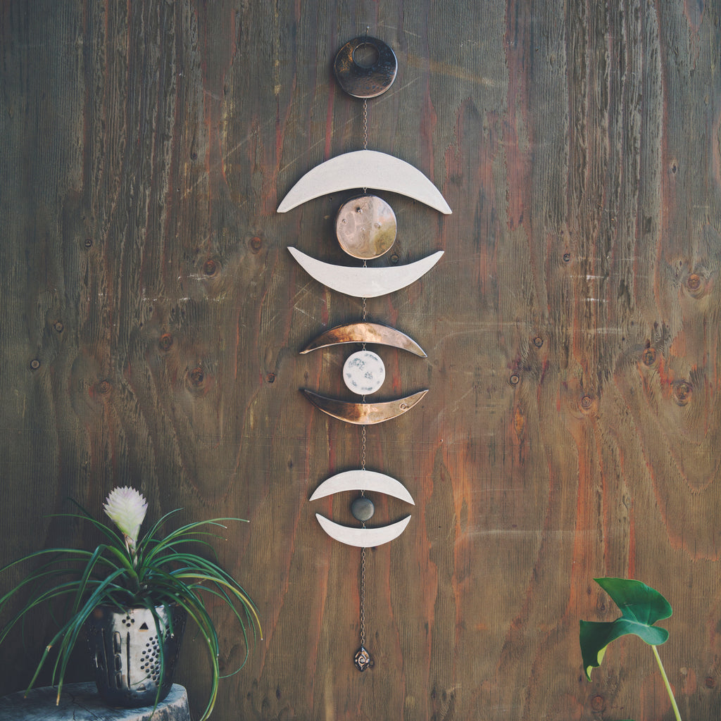 Inspired by moon phases, Whitney Sharpe is an Oakland-based artist with a handcrafted ceramic studio where she makes all of her stunning wall hangings, jewelry and home decor under The Latch Key brand.