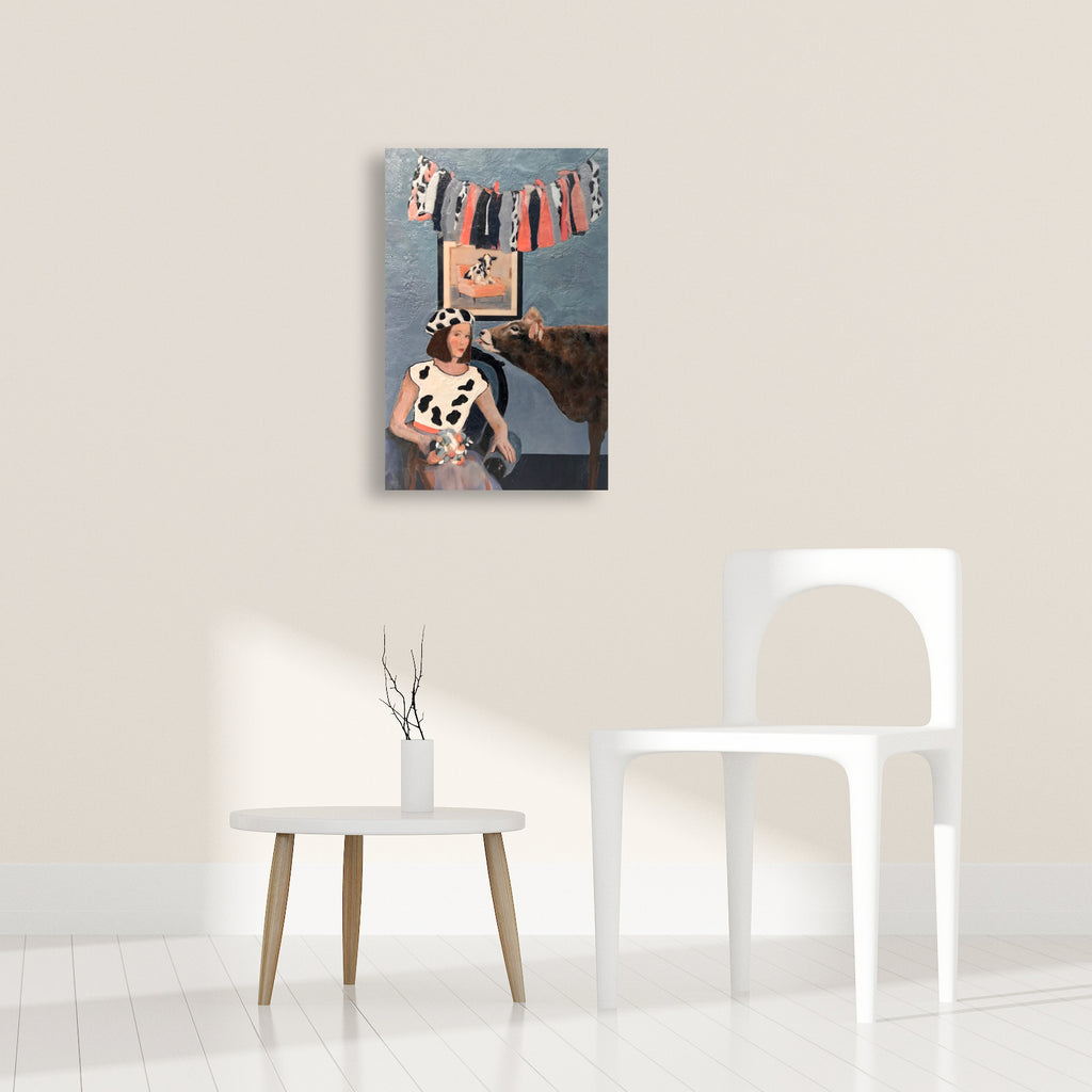 Animal prints are so du jour. We love Linda's Benenati's sense of humor at play in her Jersey Girls encaustic portrait within a portrait. Shown in an interior environment with modern furnishings.