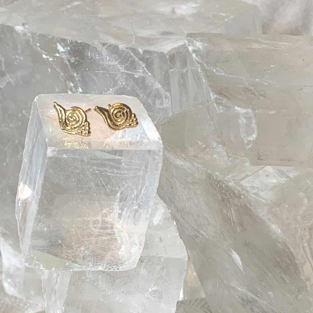 Loren Lewis Cole_Vortex Earring Studs. Shown as pair on glass cube.
