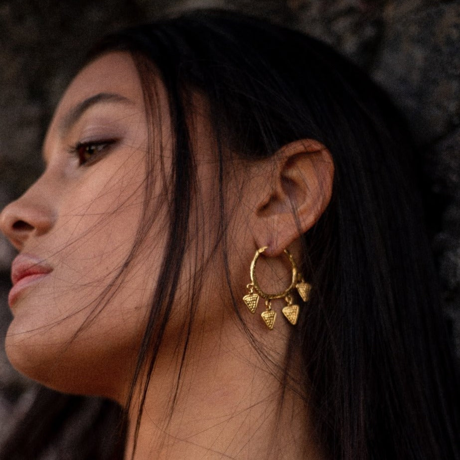 Wear the Temptress of the Vine earrings as an amulet of the rugged and vivid poetry of the natural elements and the world that beckons us.