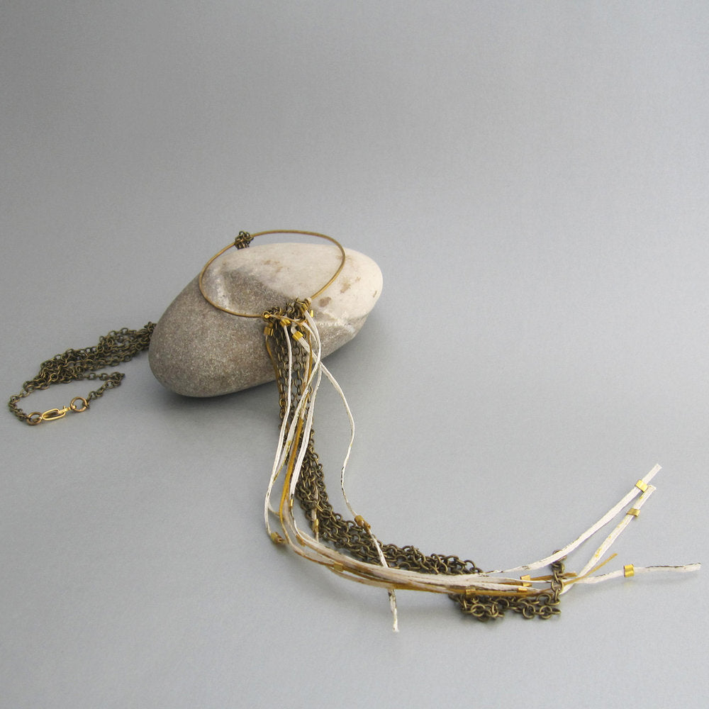 This is one of our fave pieces with its gathering of long chain and Japanese paper.