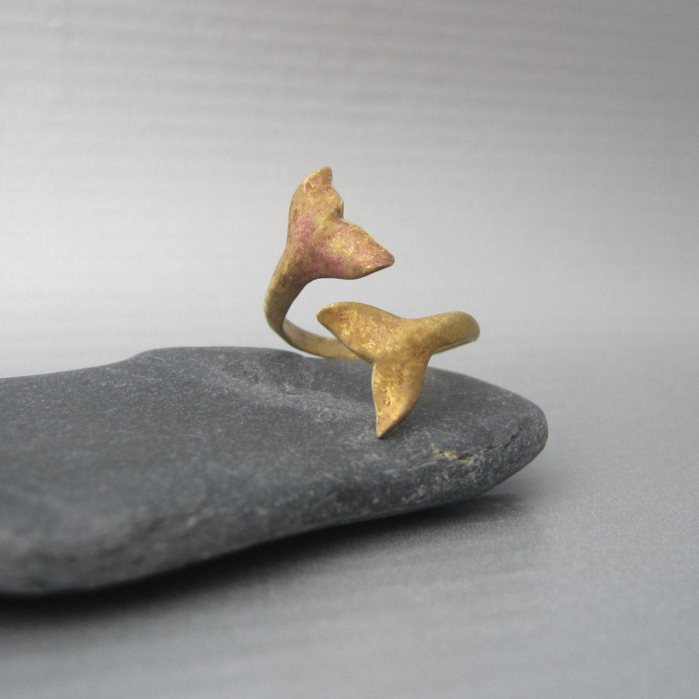 Two wild whales ready to dive into the water at sunset inspired the design of this adjustable and elegant ring.