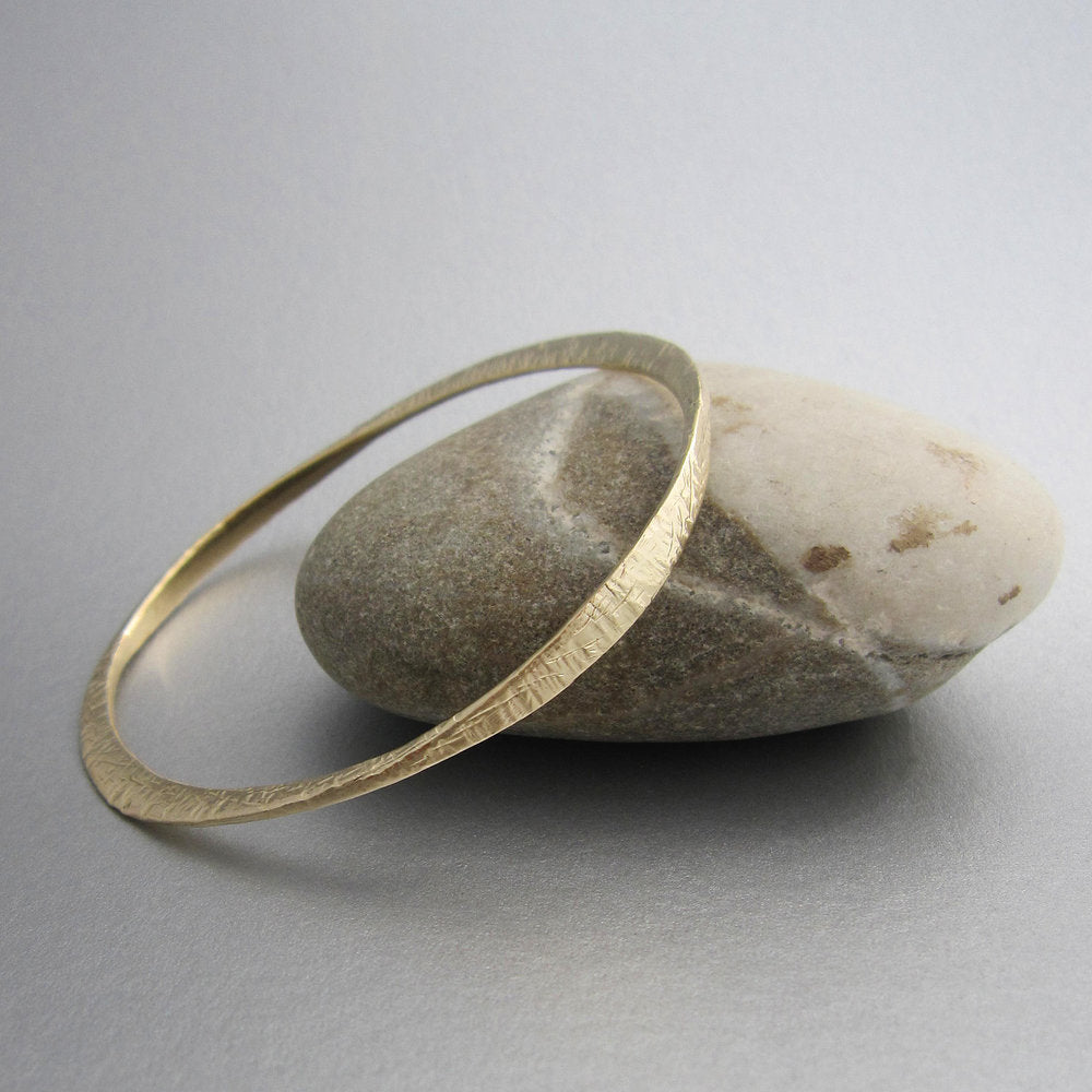 "A high tide (""marea alta"" in the language of the designer) inspired the design of these unique handmade bangles. The bracelet is elegant by itself, but it creates beautiful ""swells"" when combined with other ""marea alta"" bracelets of the same or different metals."
