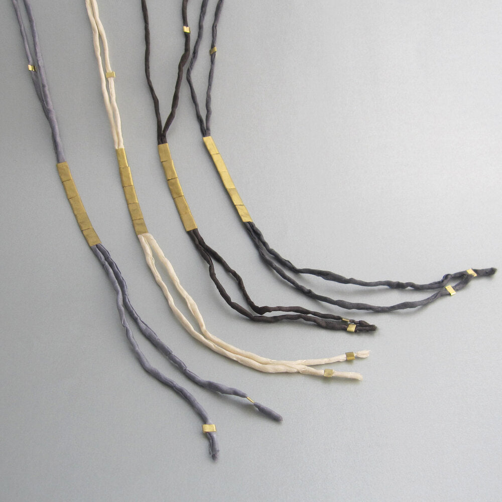"These long elegant necklaces were inspired by nature. In this case, earthworms (""Anellide"" in Italian), and their serpentine flow, helped create the language for these designs."