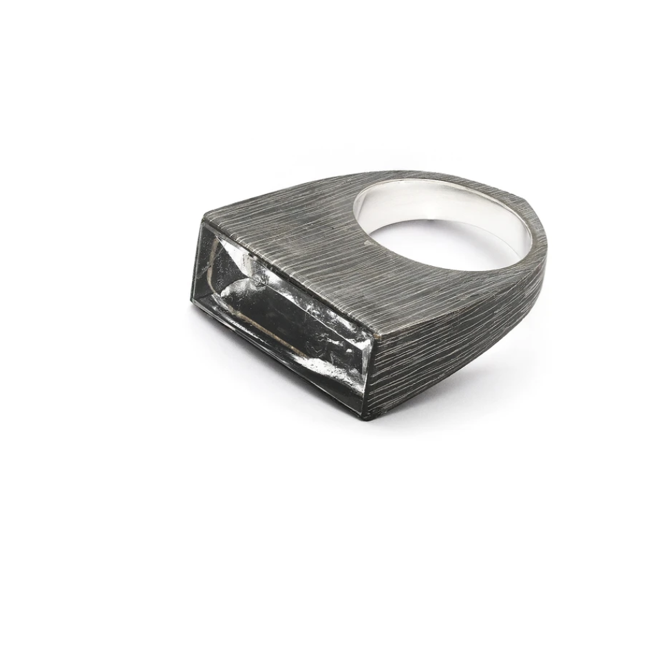 The high contrast and strong profile of these light box rings both draws in and reflects the light. Adorn your ring stack with this mood lifting accoutrement! Side view, showing hand finished, polished and oxidized silver. Top side view.
