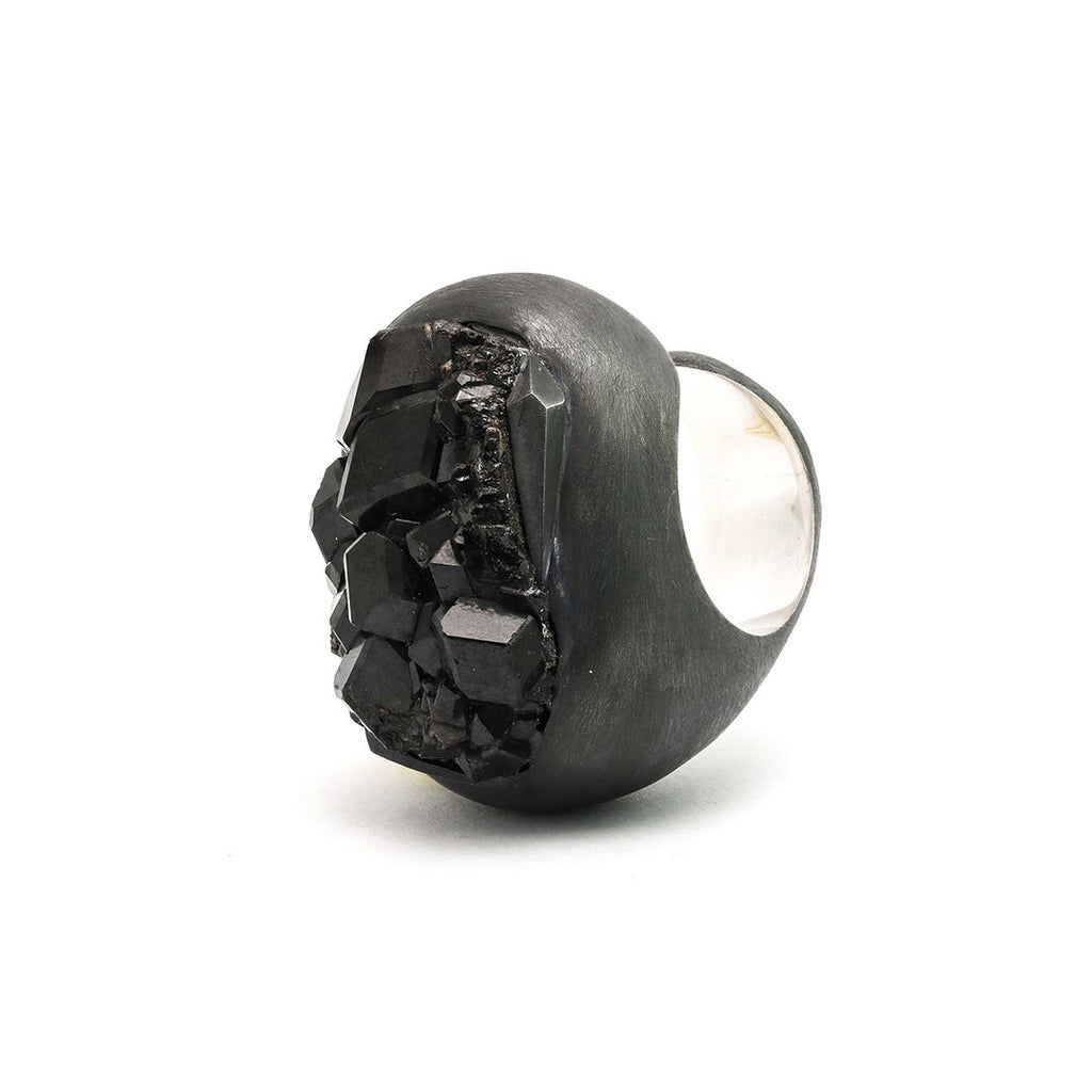 Mt Matte ring styles are a study in statement. The oxidized silver ring is embellished with curvature that in turn allows for a steady progression into angle and plane due to the cut of, and to best feature, the druse crystal itself. Front view.
