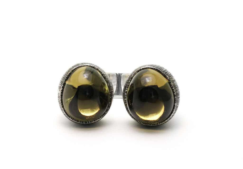 Mariella Pilato Crystal Heart Rings. Heart construction wraps around your finger with bold crystal domes on each peak, set in an etched and oxidized band. Front view smoky quartz