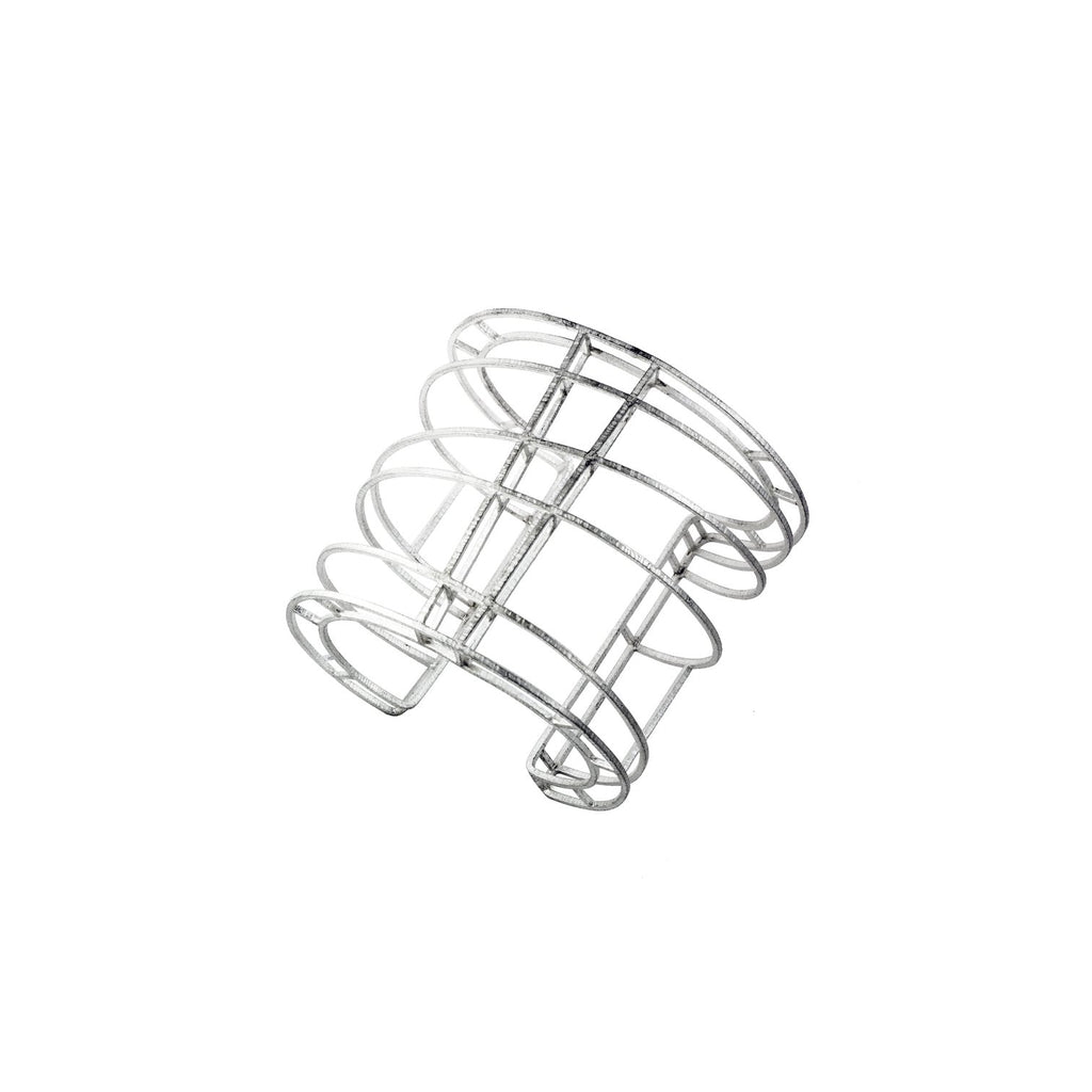 Mariella designed this cuff bracelet with two layers. A constructed state of mind, it's both light and strong.