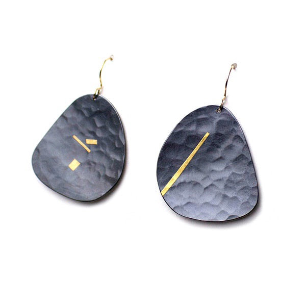These large profile Pebble dangle earrings capture the ocean murmur at night, with the moon shining gold across the seas.
