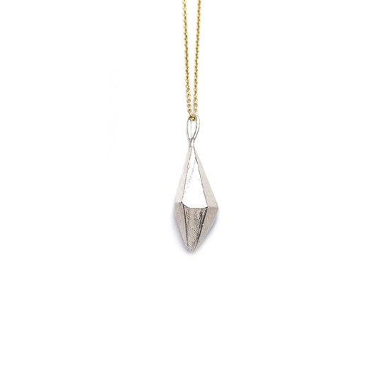 Inspired by gems, brutalist architecture and the structure of cement, this fab cast Sterling Silver pendant by Olivia Shih looks like a crystal.