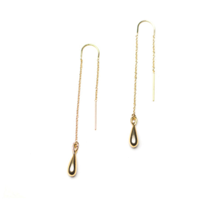With their long threader chain, these liquid gold dangle earring drops by Olivia Shih will be your fave go to for everyday elegance. Bring out a drop of sunshine in every day.