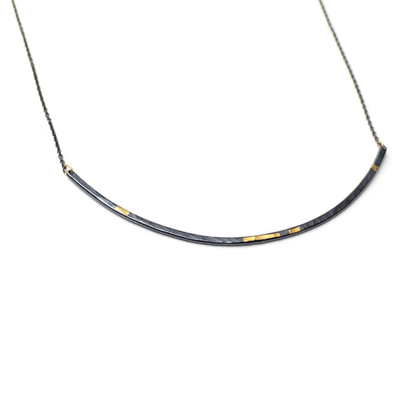 Olivia Shih's interpretation in the hammered texture, oxidized fine silver pendant and 24k gold inlay make this line necklace an every day treasure. Go for a great bold profile in the large.