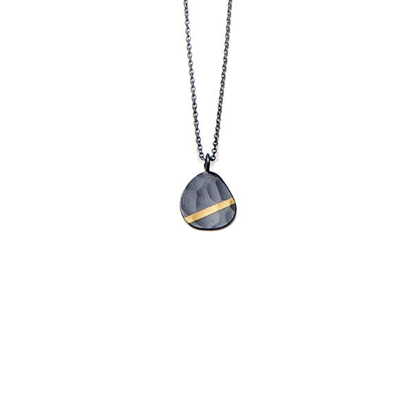 We love the ocean murmur at night, with the moon shining gold across the seas. Olivia's interpretation in the hammered texture, fine silver oxidized pendant and 24k gold inlay make this Pebble necklace an every day treasure.