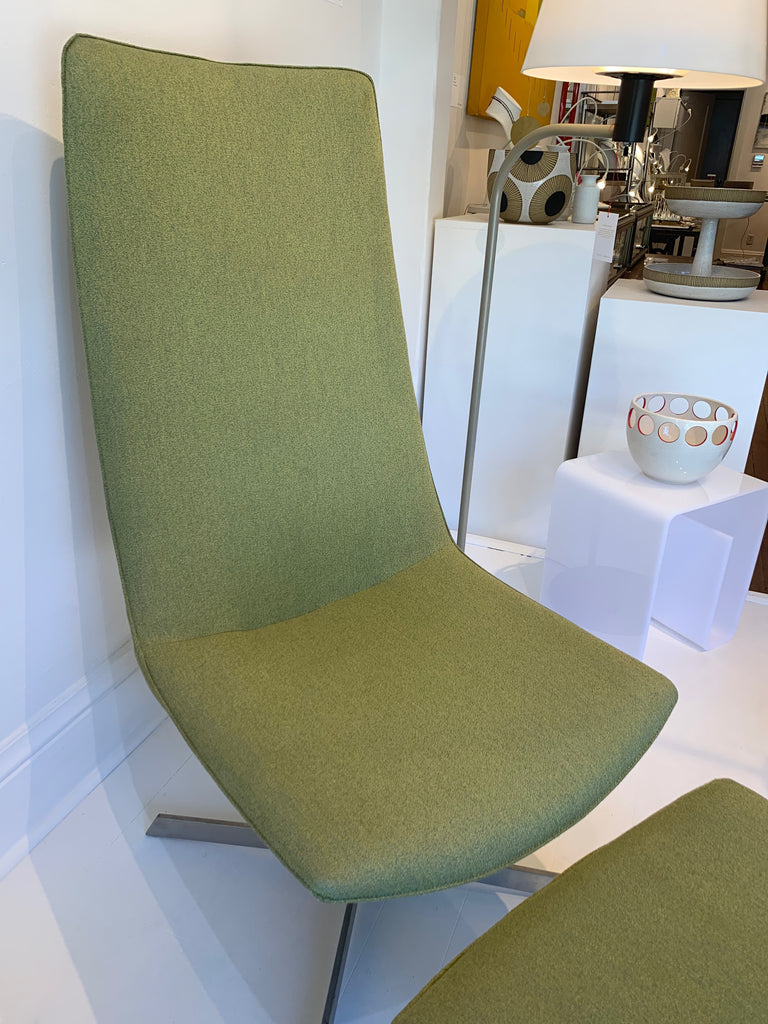 Gorgeous elegantly simple yet curvaceous Danish modern chaise lounge chair with ottoman sourced from Paris and recently recovered. Shown with Julems pottery.