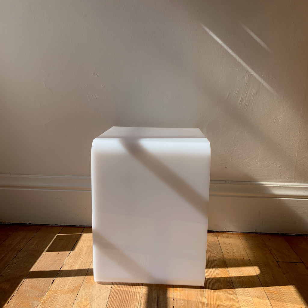 Side view of opaque lucite vintage 70s side table.